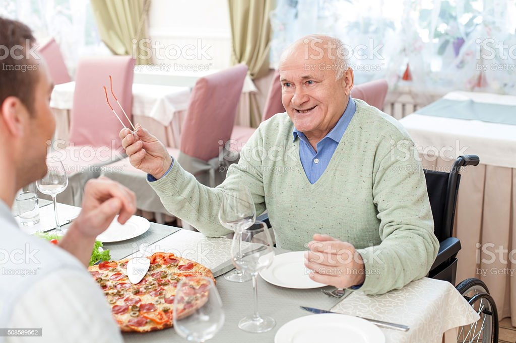 Cheerful family has a lunch in cafe stock photo