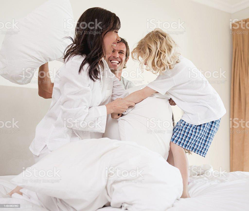 Cheerful family having pillow fight stock photo