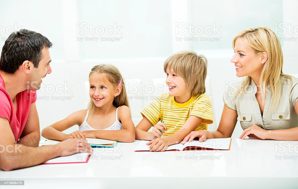 Cheerful family learning together. royalty-free stock photo