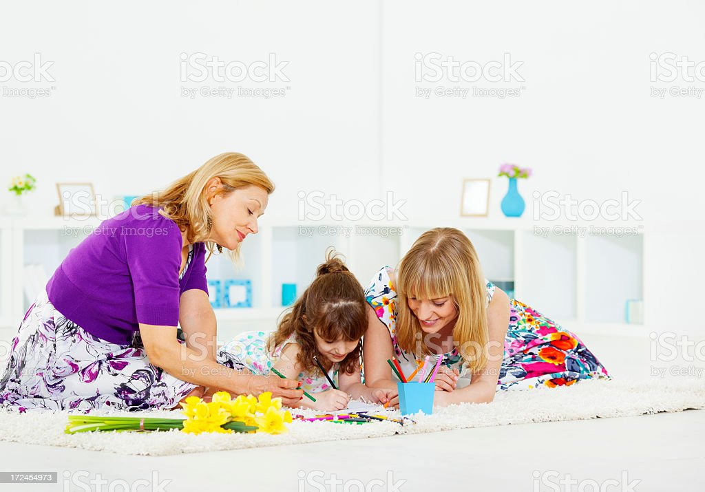 Cheerful Family Making Mothers Day Greeting Card. royalty-free stock photo