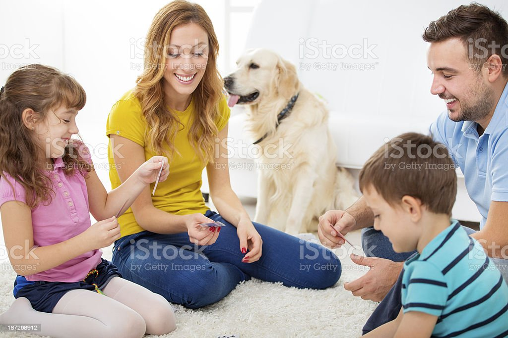Cheerful Family Playing Cards. royalty-free stock photo