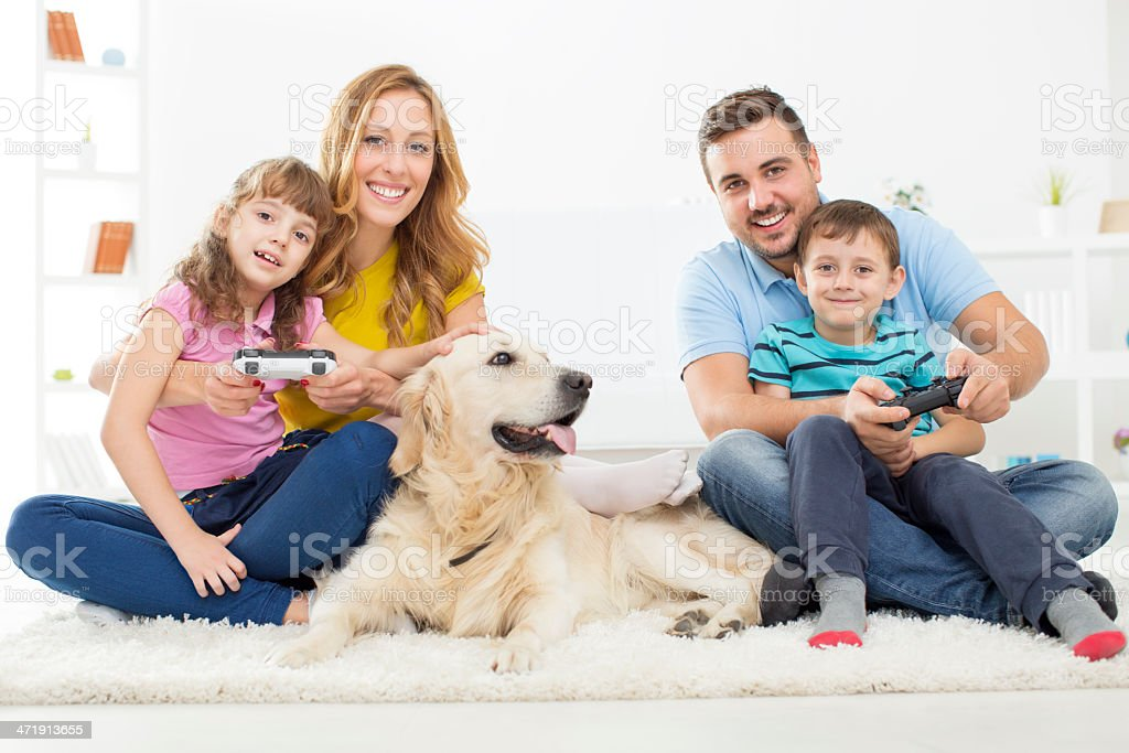Cheerful Family Playing Video Games at Home. royalty-free stock photo