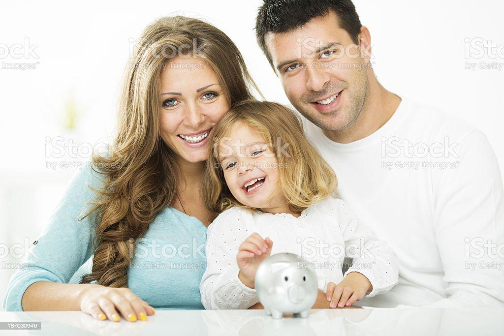 Cheerful Family Saving For Future. stock photo