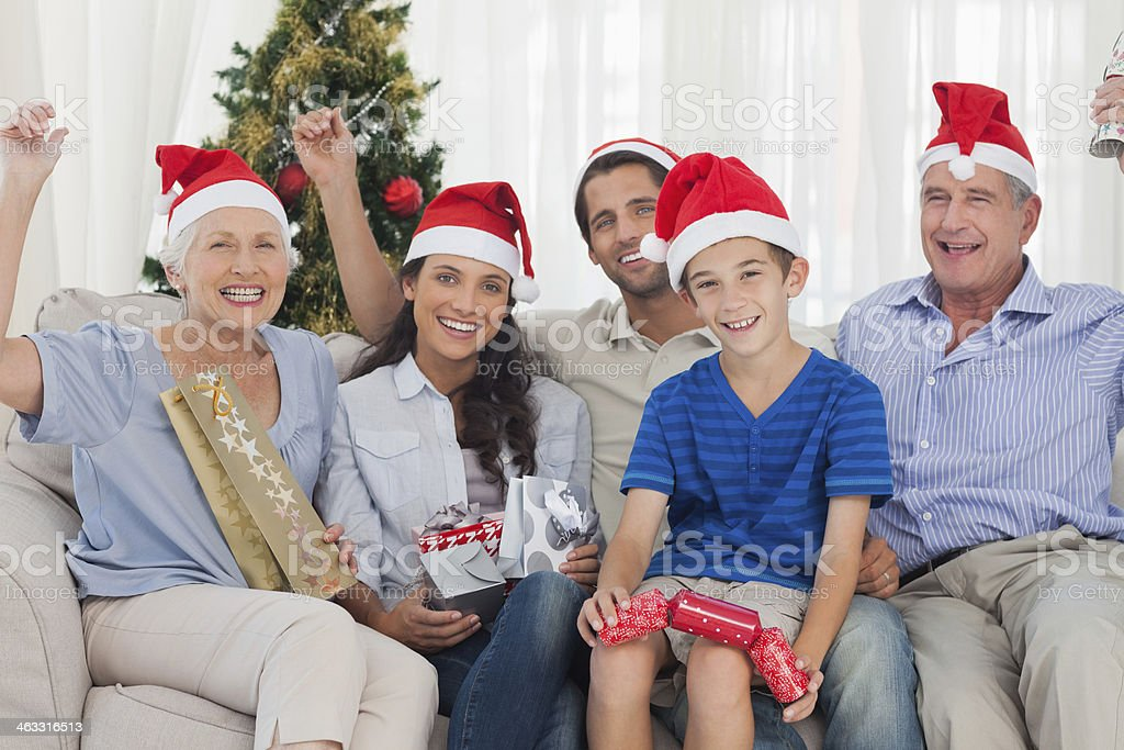 Cheerful family sitting on a couch during christmas royalty-free stock photo