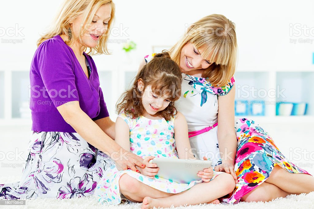 Cheerful Family Using Digital Tablet at home. royalty-free stock photo