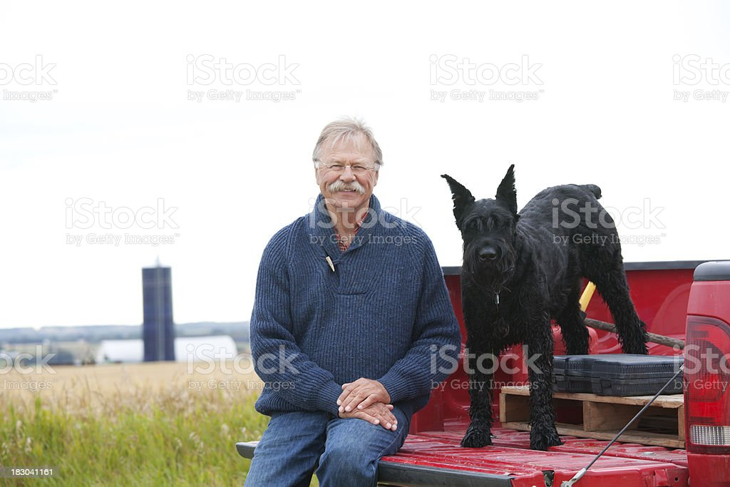 Cheerful Farmer and Dog on Farm stock photo