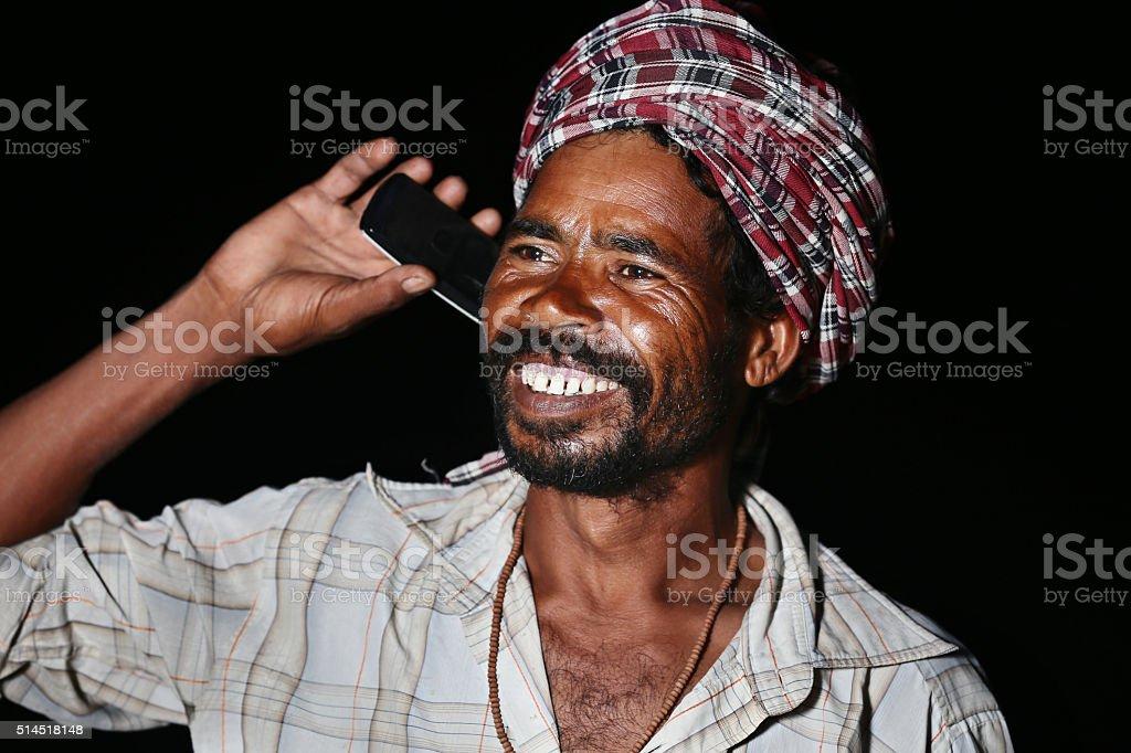 Cheerful Farmer Talking on Mobile Phone stock photo