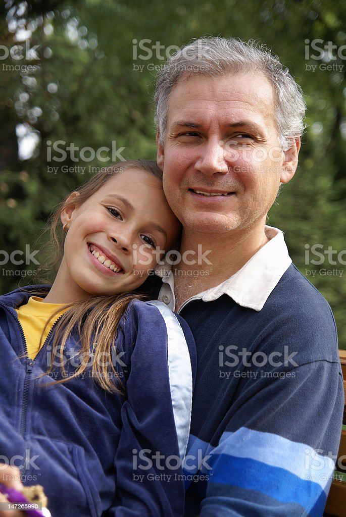 Cheerful father and daughter talking royalty-free stock photo