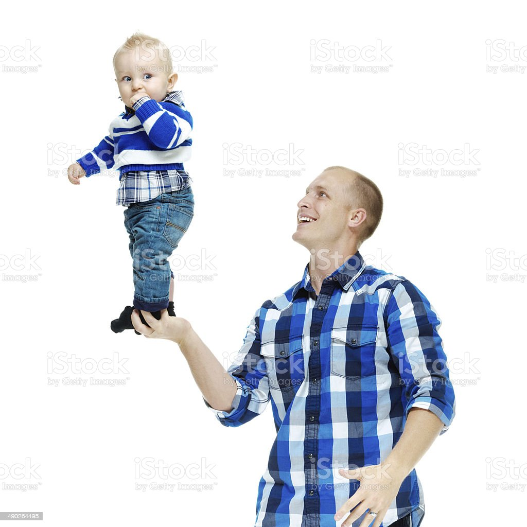 Cheerful father playing with his baby royalty-free stock photo