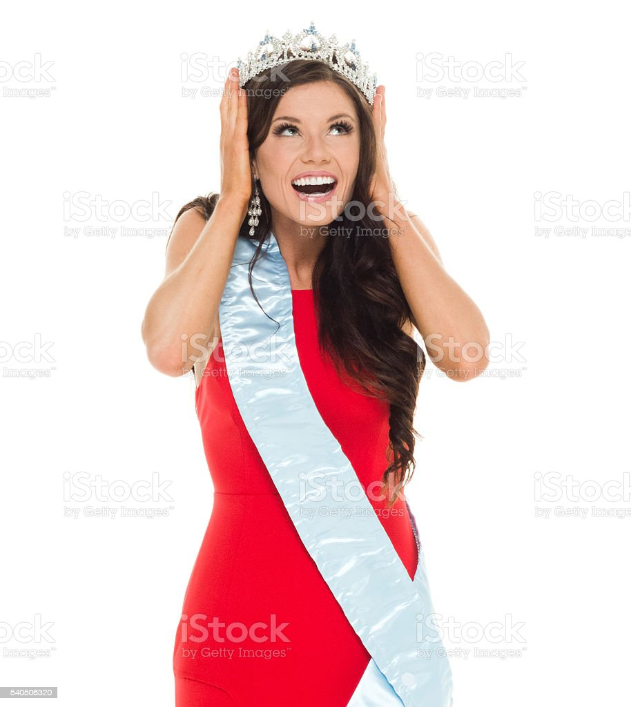 Cheerful female beauty queen covering her ears stock photo
