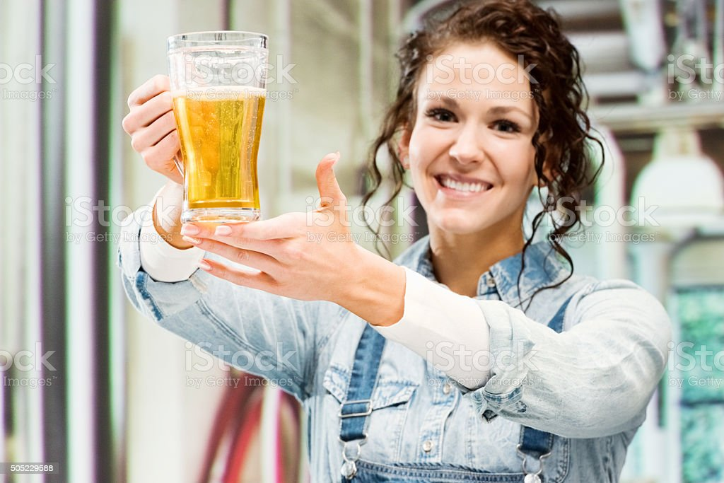 Cheerful female brewmaster at a brewery stock photo