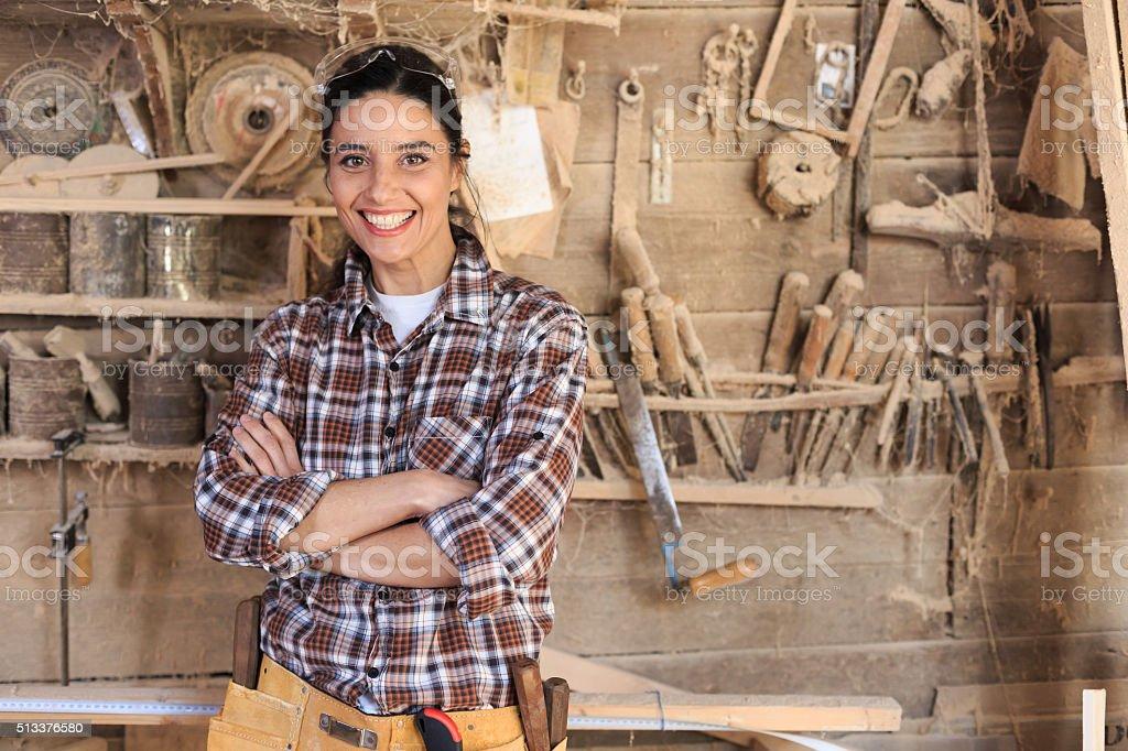 Cheerful female carpenter stock photo
