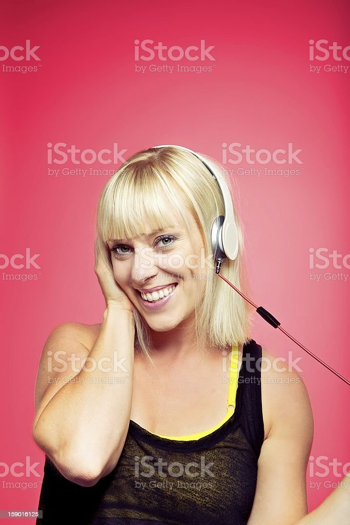 Cheerful Female Listening to Funky Music royalty-free stock photo