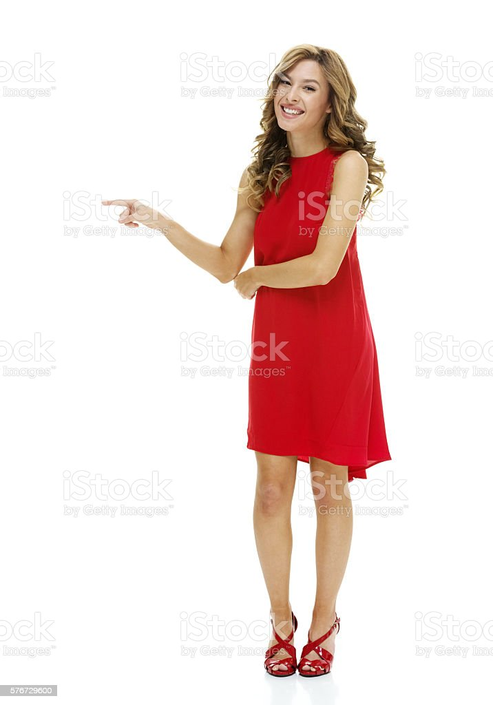Cheerful female pointing away stock photo