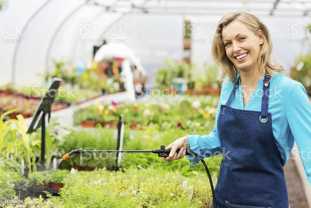 Cheerful Female Worker Spraying Insecticide royalty-free stock photo