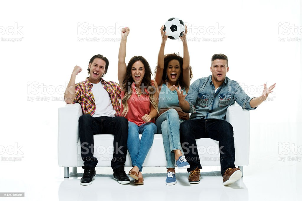 Cheerful four friends cheering stock photo