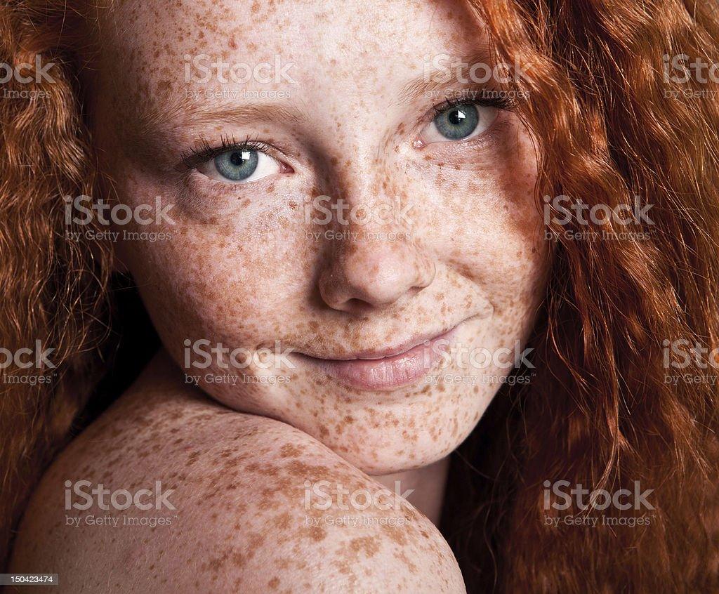 Cheerful freckled girl stock photo