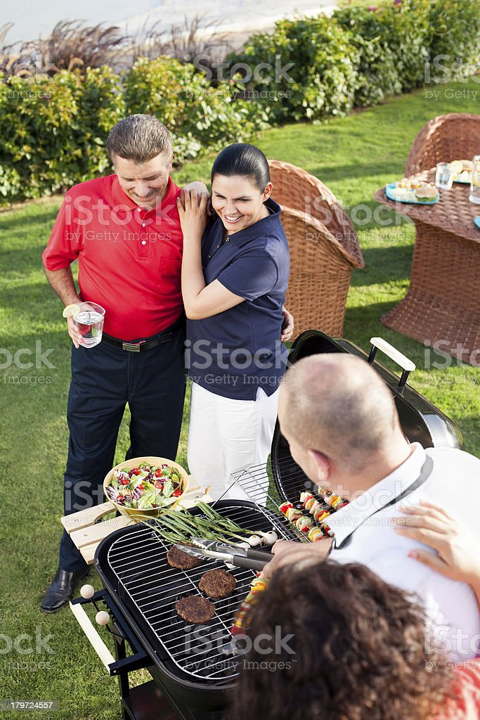 Cheerful friends having a barbecue royalty-free stock photo