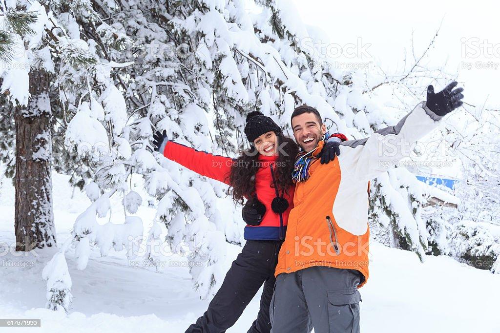 Cheerful friends having fun in snow mountain stock photo