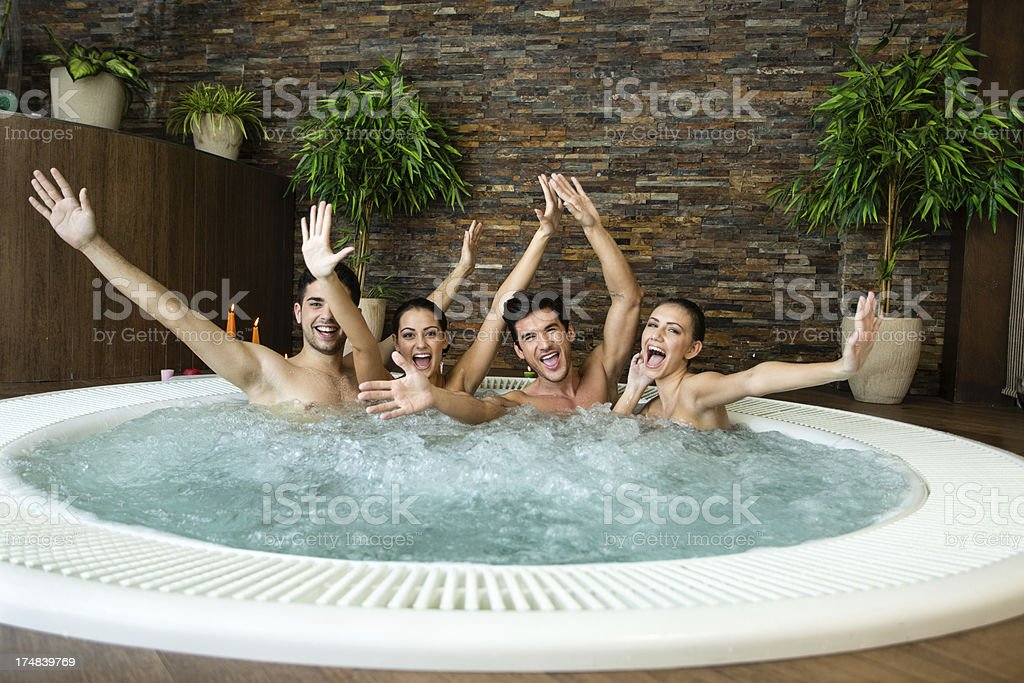 Cheerful friends in jacuzzi royalty-free stock photo