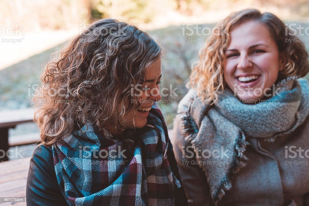 Cheerful friends laughing in the nature stock photo