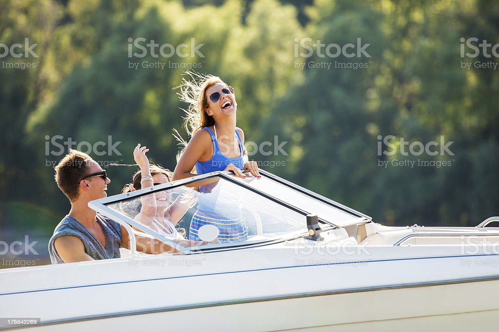 Cheerful friends on a speedboat. stock photo