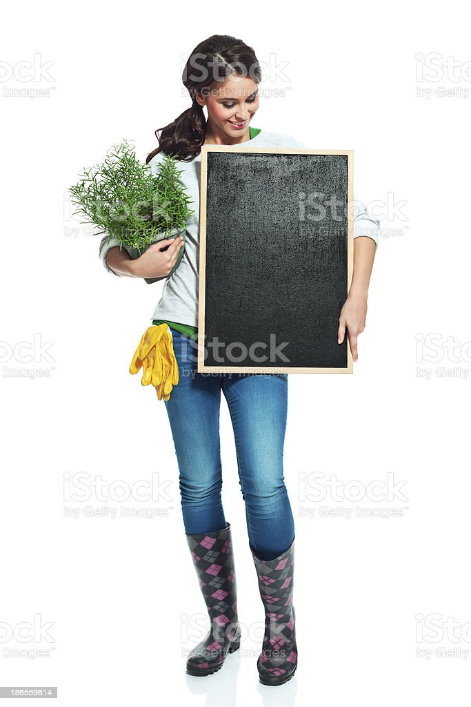 Cheerful gardener with blackboard royalty-free stock photo