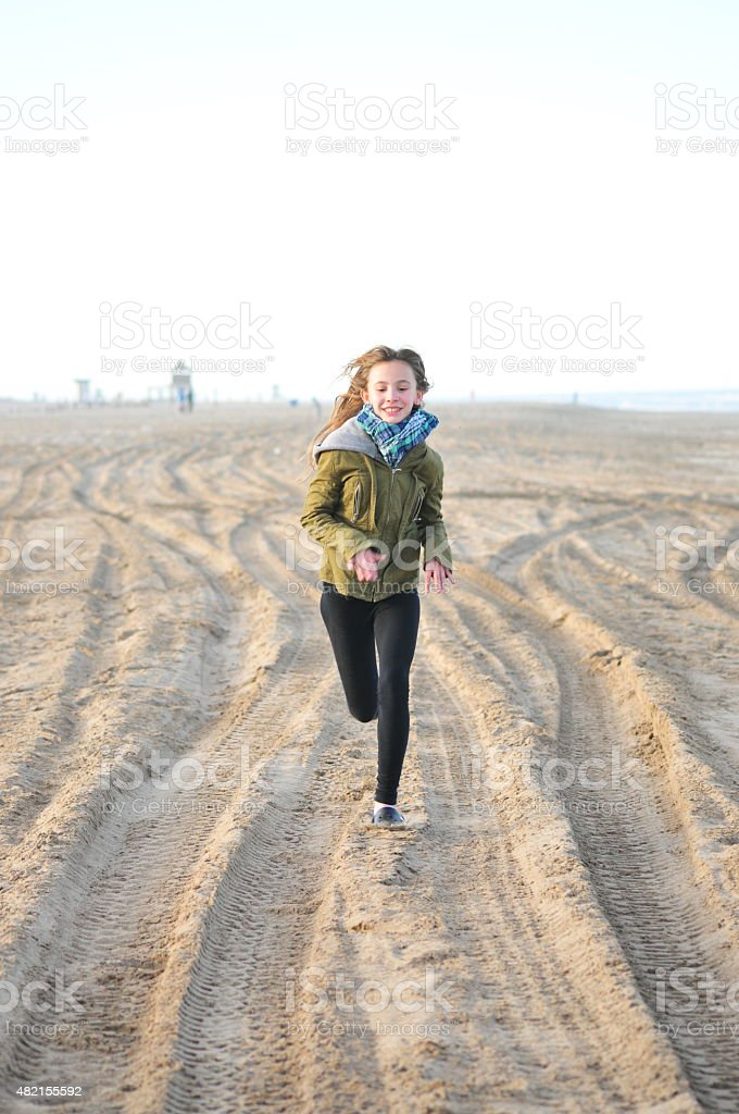 Cheerful girl at the beach stock photo