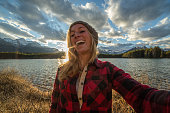 Cheerful girl capturing beautiful moments in nature-Selfie