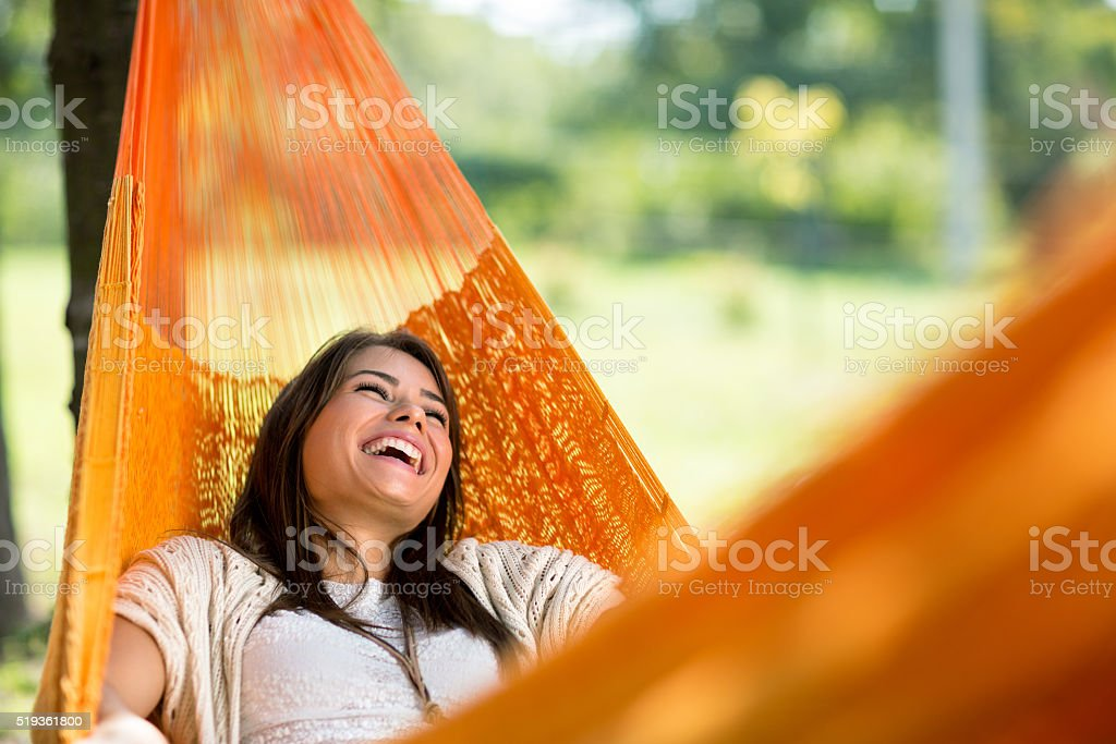 Cheerful girl enjoy in hammock royalty-free stock photo