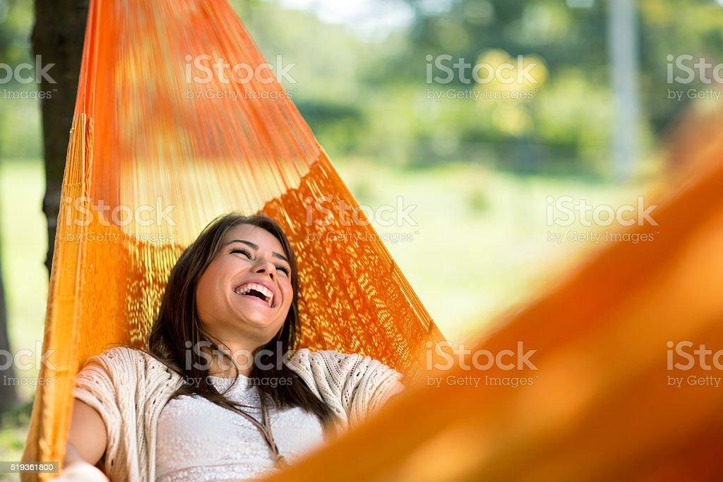 Cheerful girl enjoy in hammock stock photo