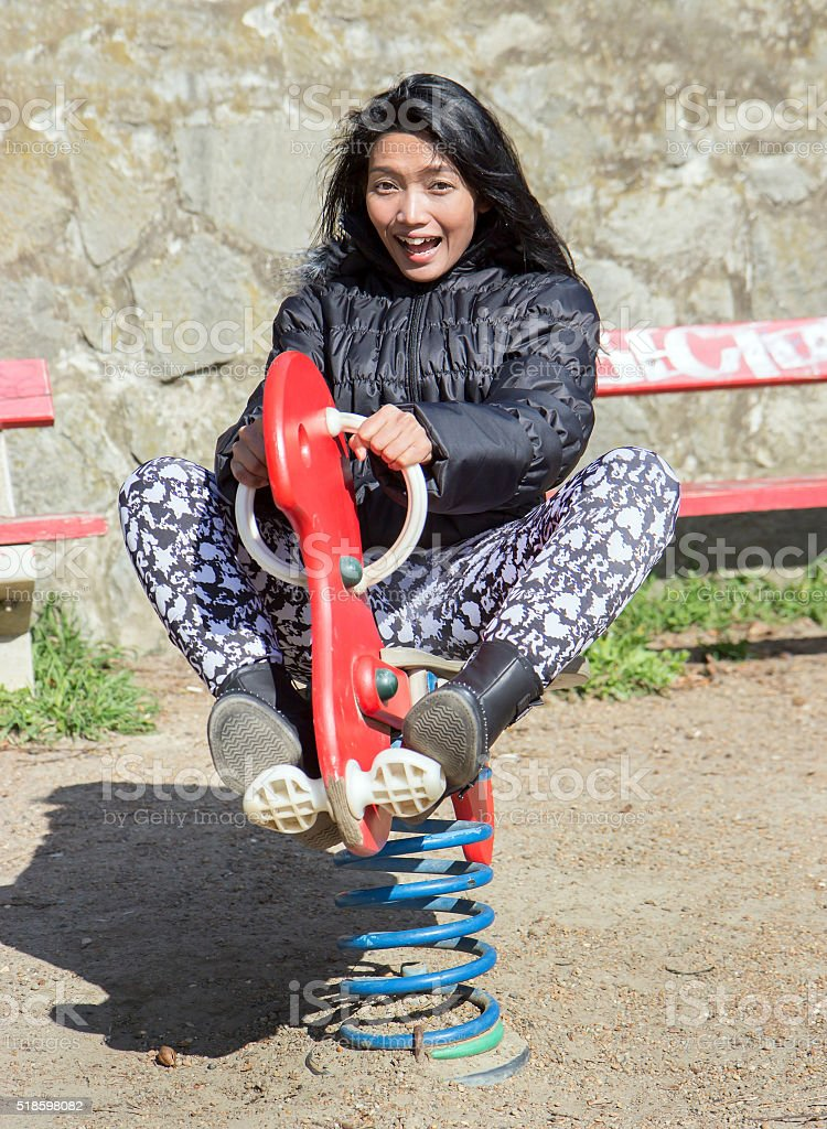 cheerful girl enjoying on the swing stock photo