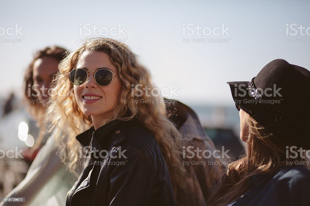 Cheerful girl enjoys her friends outside stock photo