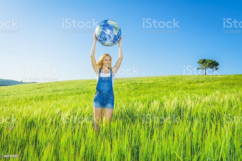 Cheerful girl holding a world globe royalty-free stock photo
