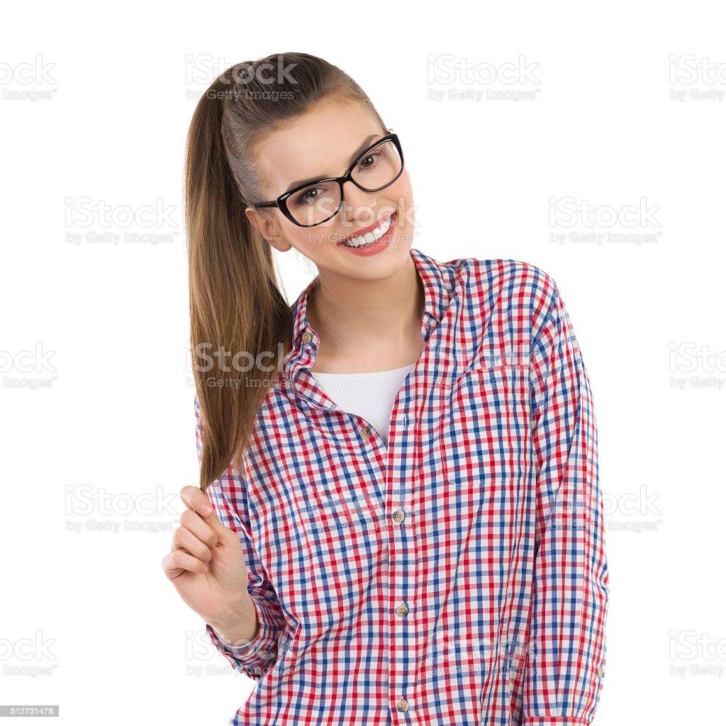 Cheerful Girl In Lumberjack Shirt stock photo