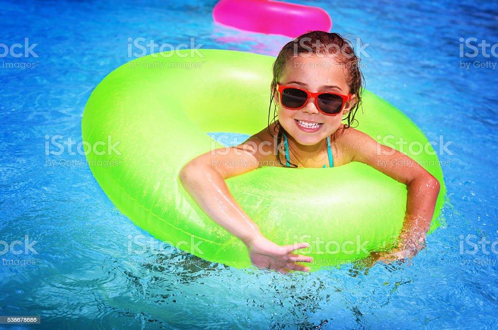 Cheerful girl in swimming pool stock photo