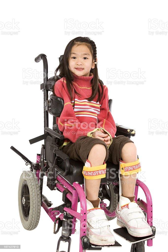 Cheerful girl in wheelchair royalty-free stock photo