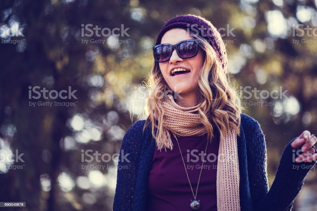 Cheerful Girl Laughing At Park stock photo