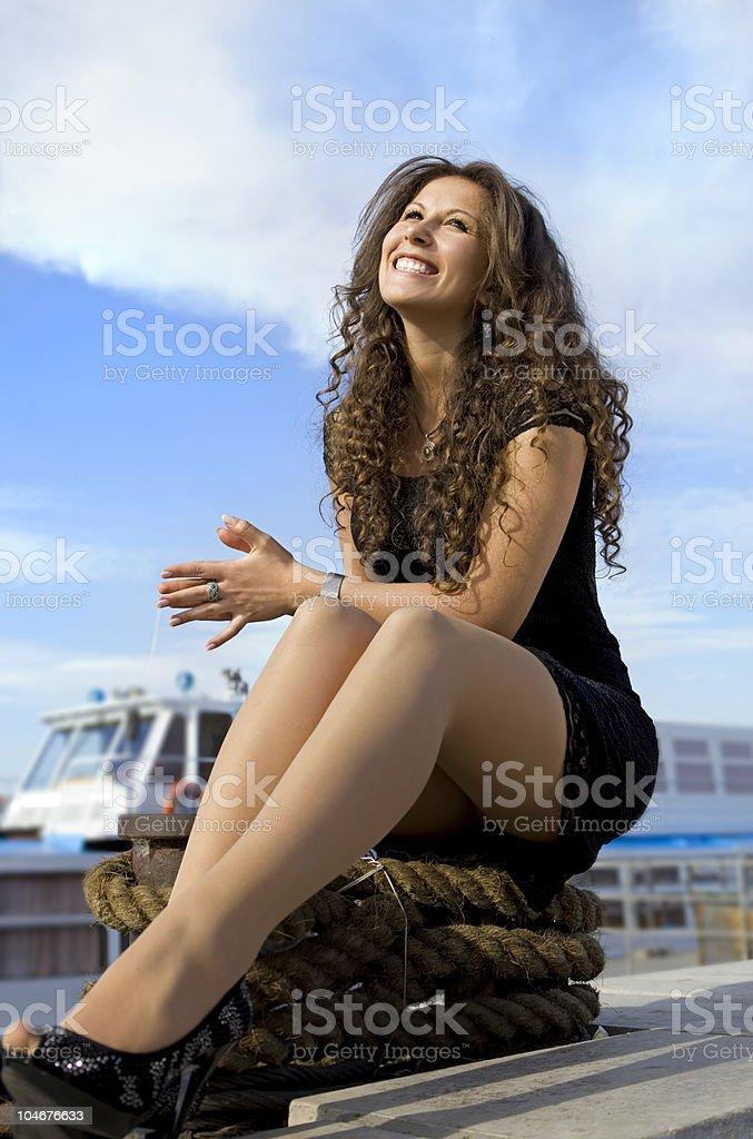 cheerful girl on landing stage stock photo