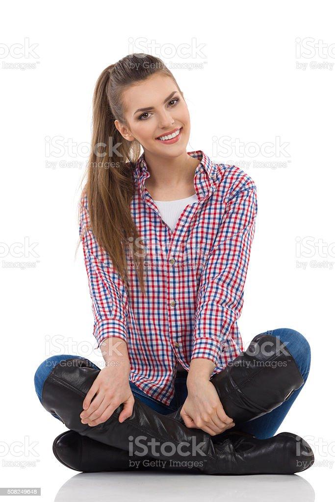 Cheerful Girl Sitting Legs Crossed stock photo