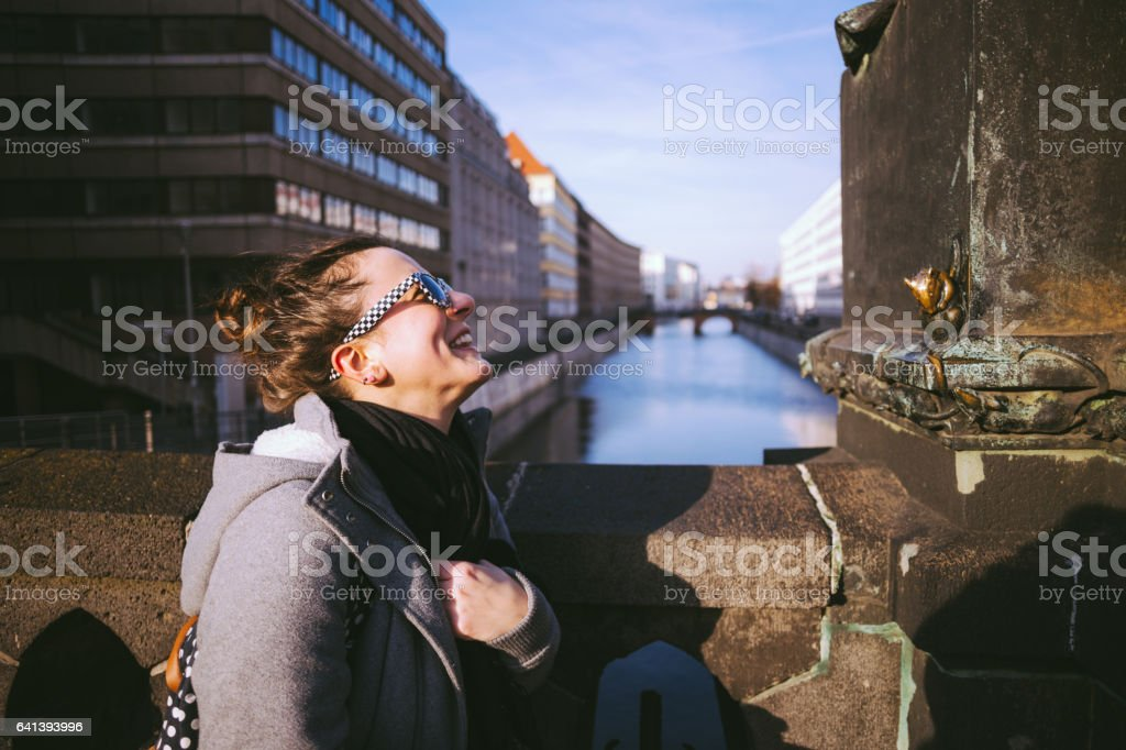 Cheerful Girl Standing On Bridge stock photo