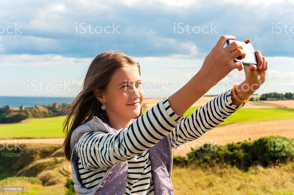 Cheerful girl taking selfie in Scotland Aberdeen and Grampian Highlands stock photo