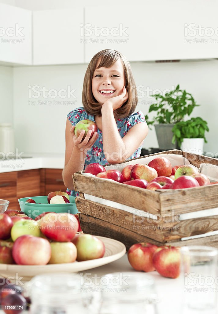 Cheerful girl with apples royalty-free stock photo