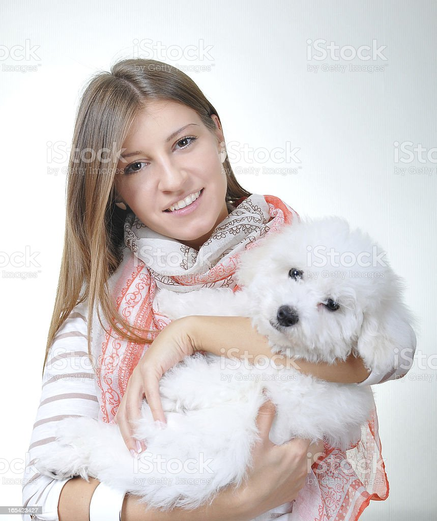 Cheerful girl with her dog royalty-free stock photo