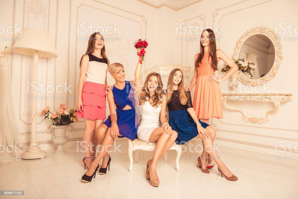 Cheerful girls celebrating a bachelorette party stock photo