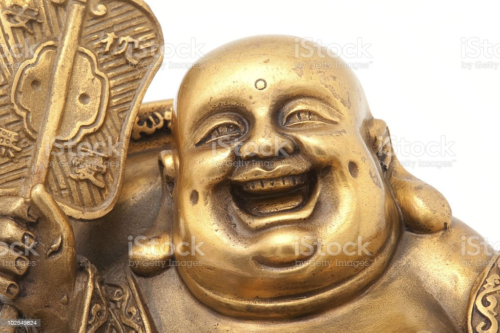 Cheerful Golden Hotei. Chinese God of Wealth. stock photo