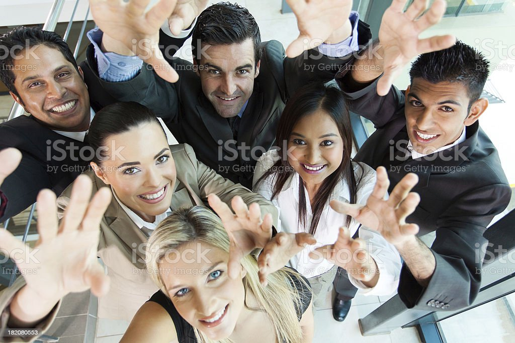 cheerful group of business people reach out royalty-free stock photo