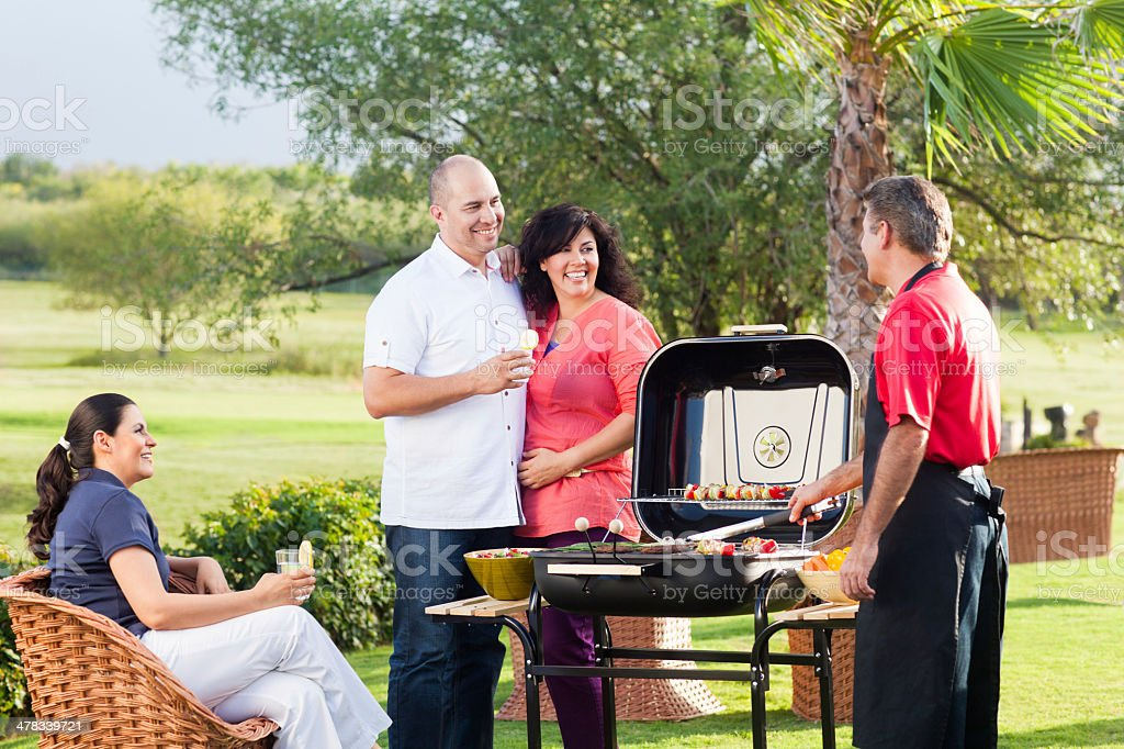 Cheerful group of friends in a barbecue royalty-free stock photo