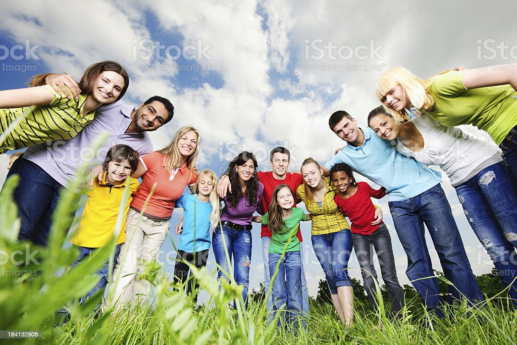 Cheerful group of young people looking at the camera. royalty-free stock photo