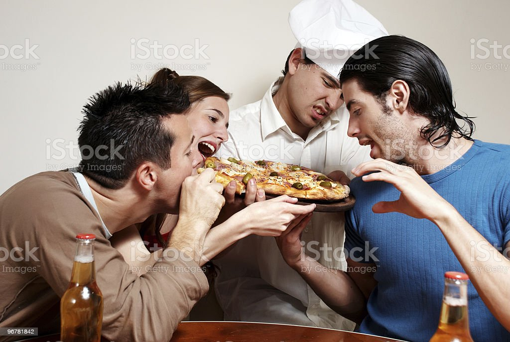 Cheerful group of youth in a pizza royalty-free stock photo